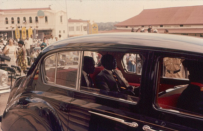 Milton Obote in a motorcade on Kampala Road during Independence celebrations. October 9th 1962. Photograph by Malcom McCrow. 1962. Courtesy of artist.